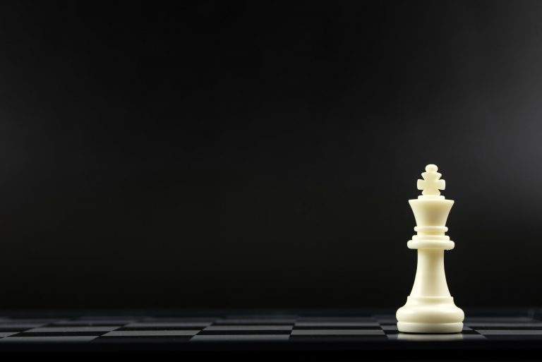 White king chess piece standing